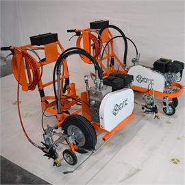 Hand held road marking machines