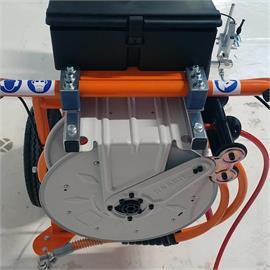 Carrete de manguera para dispositivos sin aire